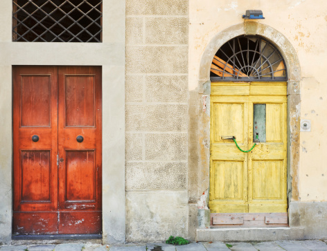 Yellow And Red Front Door Entrances Weathered Stock Photo - Download Image Now