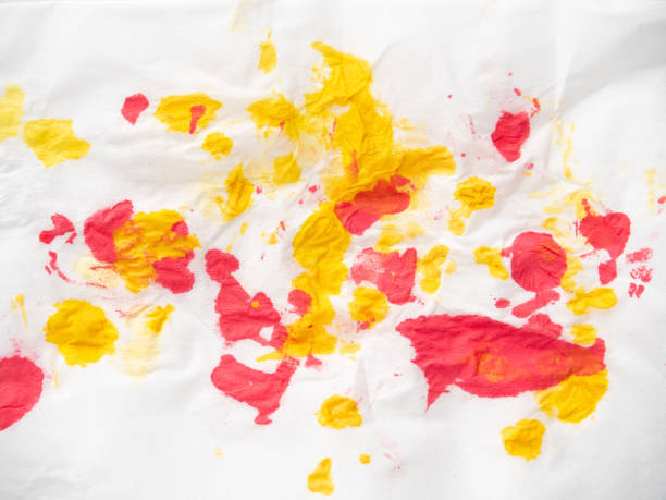 Yellow and red inkblots on white paper, close up view. Abstract pattern of paint spots on white background. Colourful abstract background. Yellow and red inkblots on white paper, close up view. Abstract pattern of paint spots on white background. Colourful abstract background blotting paper stock pictures, royalty-free photos & images
