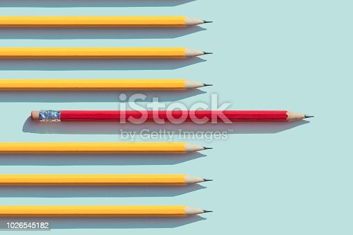 Yellow and red  pencils on blue  background