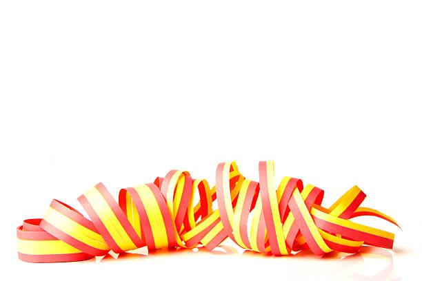 a yellow and red ribbon on a white background - blue yellow band bildbanksfoton och bilder