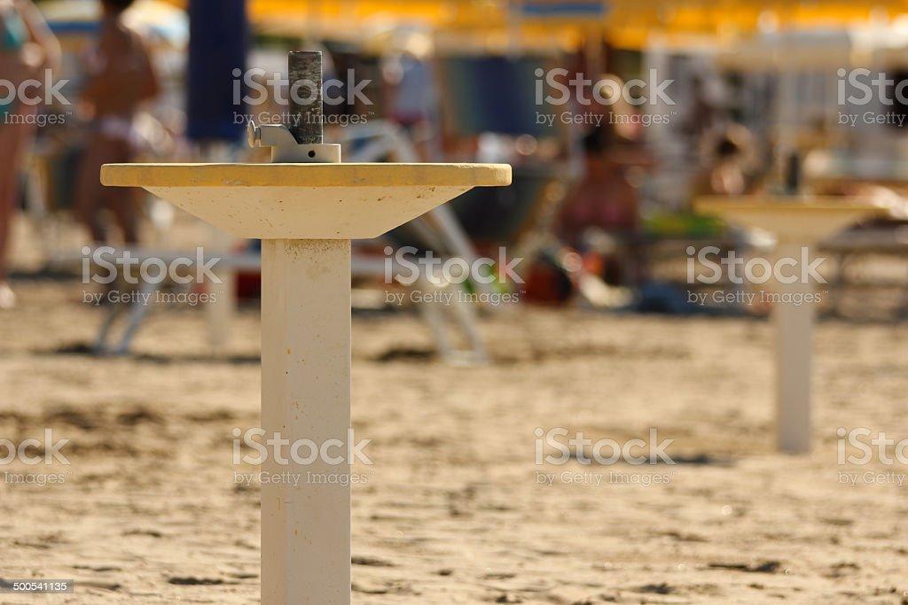 Yellow and white beach umbrella pedestal royalty-free stock photo