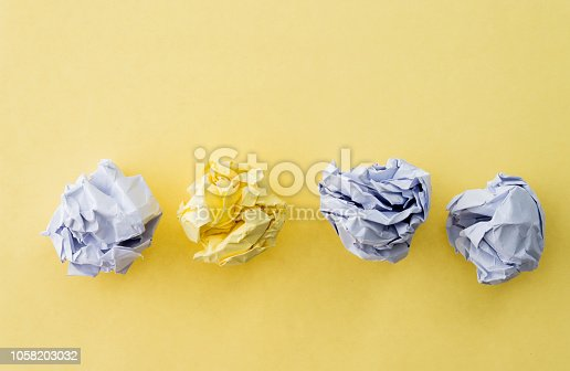 istock Yellow and white paper balls on yellow background 1058203032