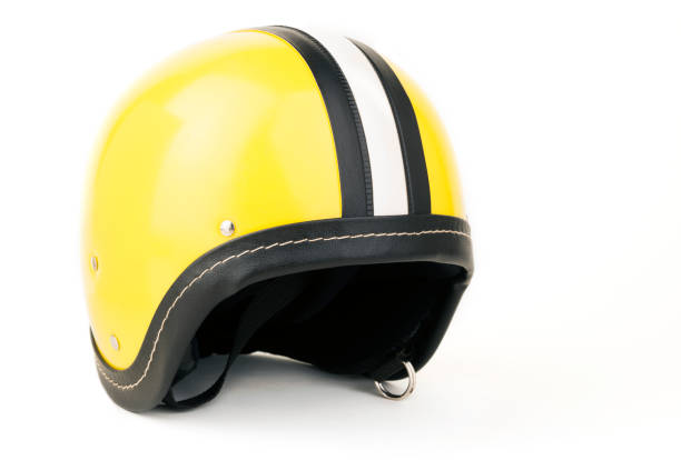 a yellow and white striped motorcycle helmet isolated on white - crash helmet stock photos and pictures
