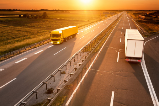 Yellow And White Truck In Motion Blur On The Highway Stock Photo - Download Image Now