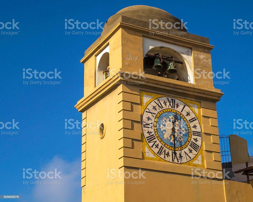 Yellow antique tower clock in Capri Island stock photo