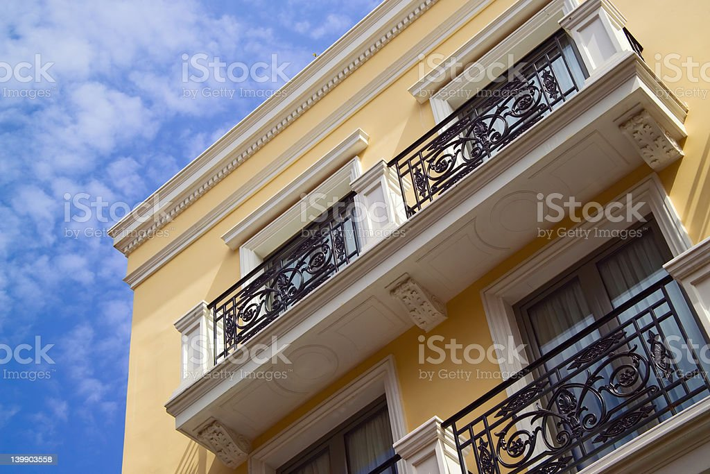 Yellow apartment building, blue sky royalty-free stock photo