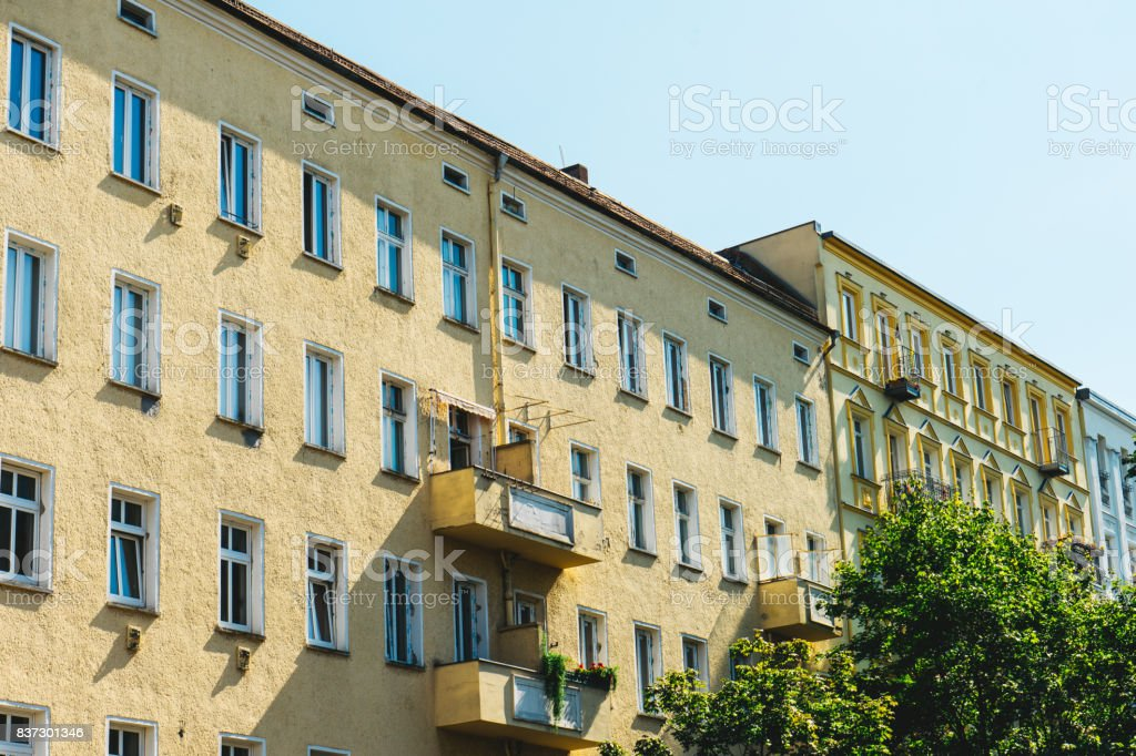 yellow apartment houses in a row stock photo