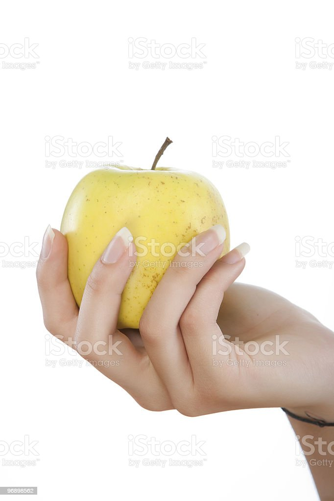 yellow apple in hand royalty-free stock photo