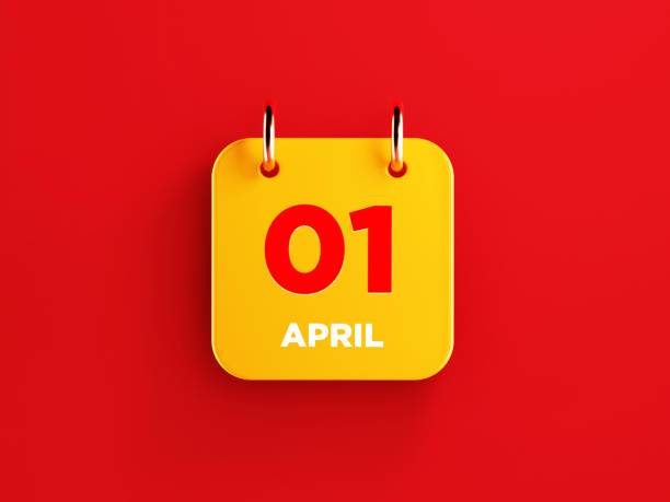 Yellow April 1 Calendar on Red Background Yellow calendar on red background. April 1 writes on the calendar. Horizontal composition with copy space. Top view. april fools day stock pictures, royalty-free photos & images