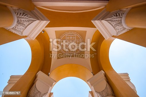 Yellow arch architecture in roman style