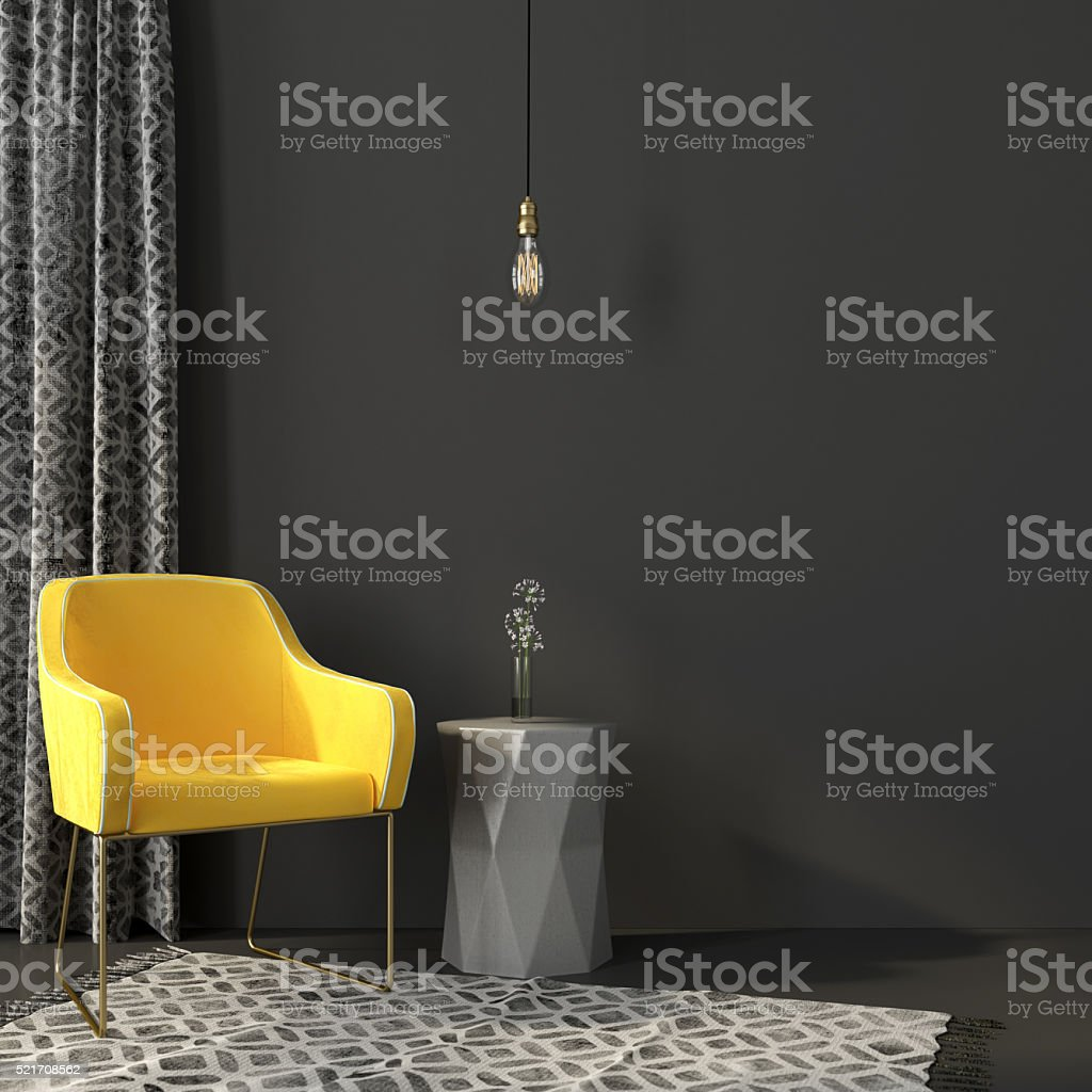 Yellow armchair in a gray interior stock photo