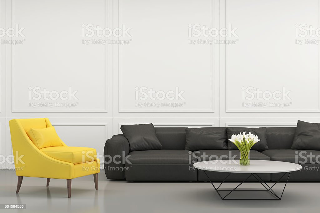Yellow armchair with a black sofa stock photo