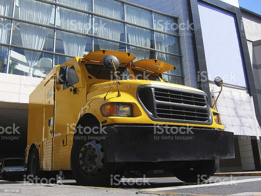 Yellow armored truck stock photo