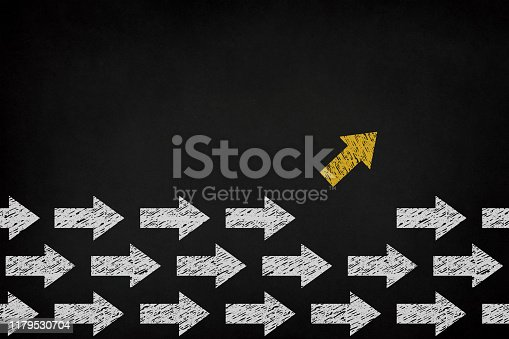 1088508096 istock photo Yellow arrow coming out from the advancing white arrows on chalkboard, different business concept 1179530704