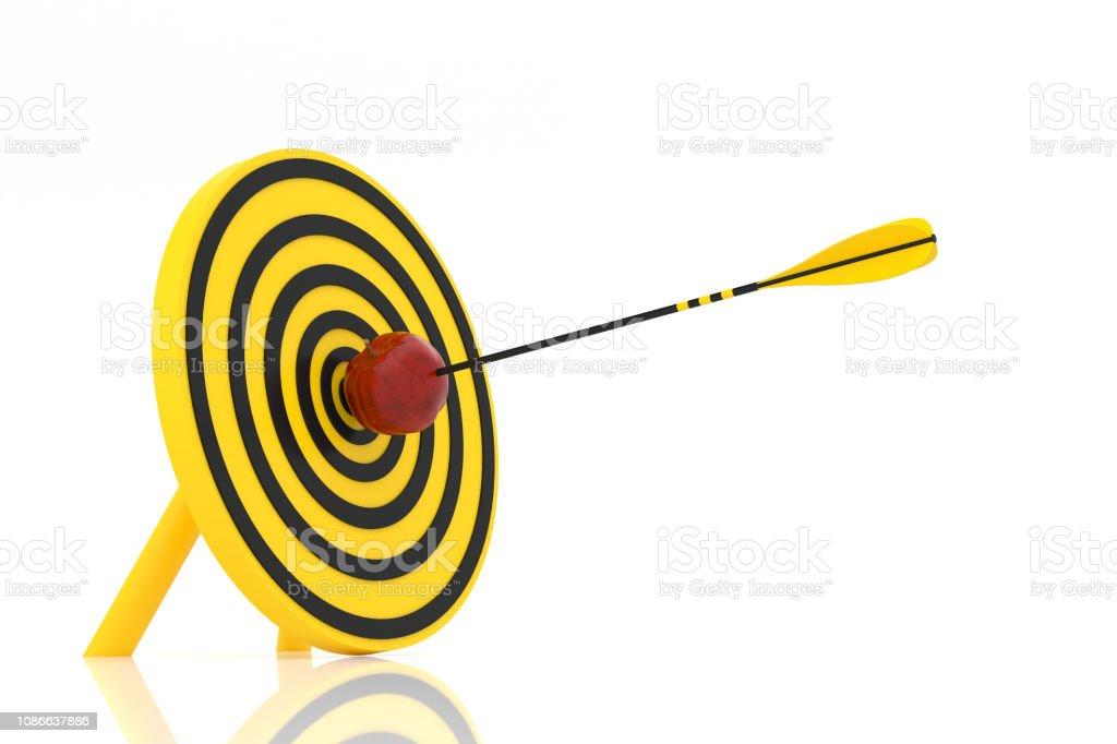 Yellow arrow hit the red apple stock photo
