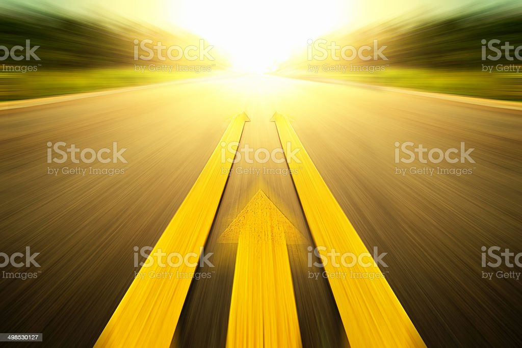 Yellow arrow Line exceeding on the road. stock photo