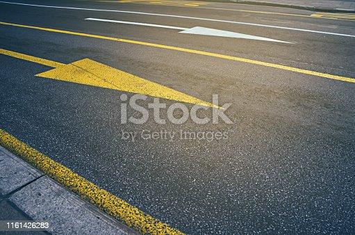 istock Yellow arrow road sign 1161426283