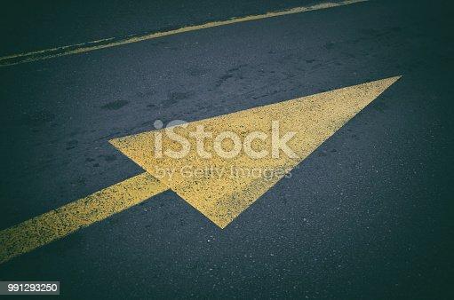 istock Yellow arrow road sign 991293250