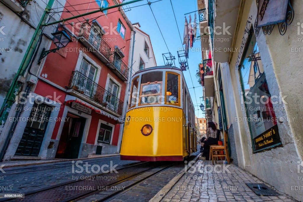 Yellow Ascensor da Bica on its way down in Lisbon stock photo