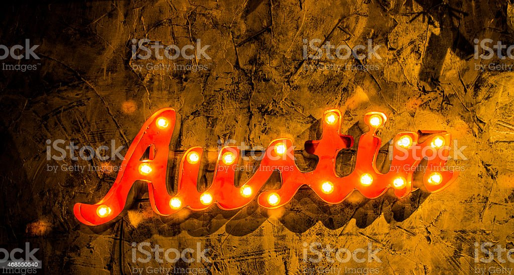 Yellow Austin Wall Sign Hanging on Wall stock photo