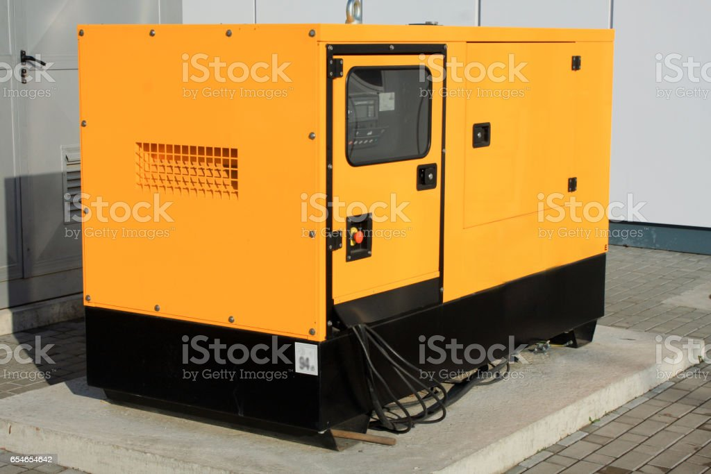 Yellow Auxiliary Diesel Generator for Emergency Electric Power stock photo