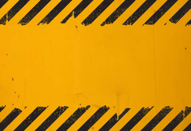 yellow background with black grunge hazard sign - alarm stock pictures, royalty-free photos & images