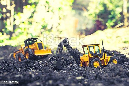 Trucks working on the black soil in the garden.