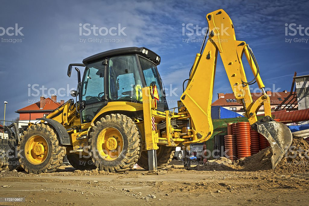 Yellow Backhoe in construction site royalty-free stock photo
