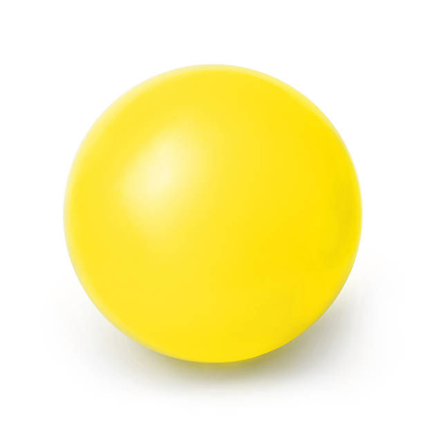yellow ball isolated on a white background - ball stock photos and pictures