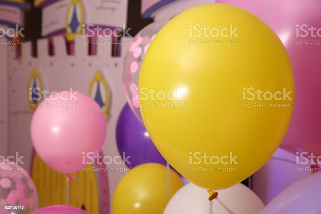 yellow balloon and childrens castle selective focus royalty free stock photo