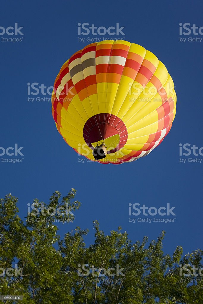 yellow balloon flying in summer royalty-free stock photo