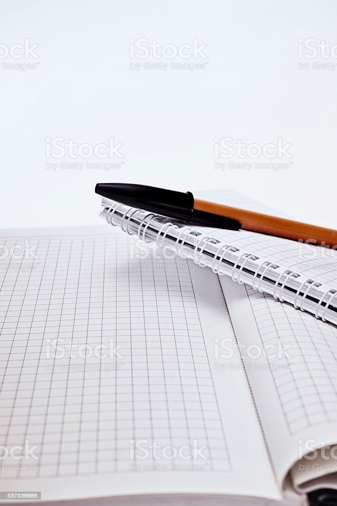 Yellow ballpen and two notebook stock photo