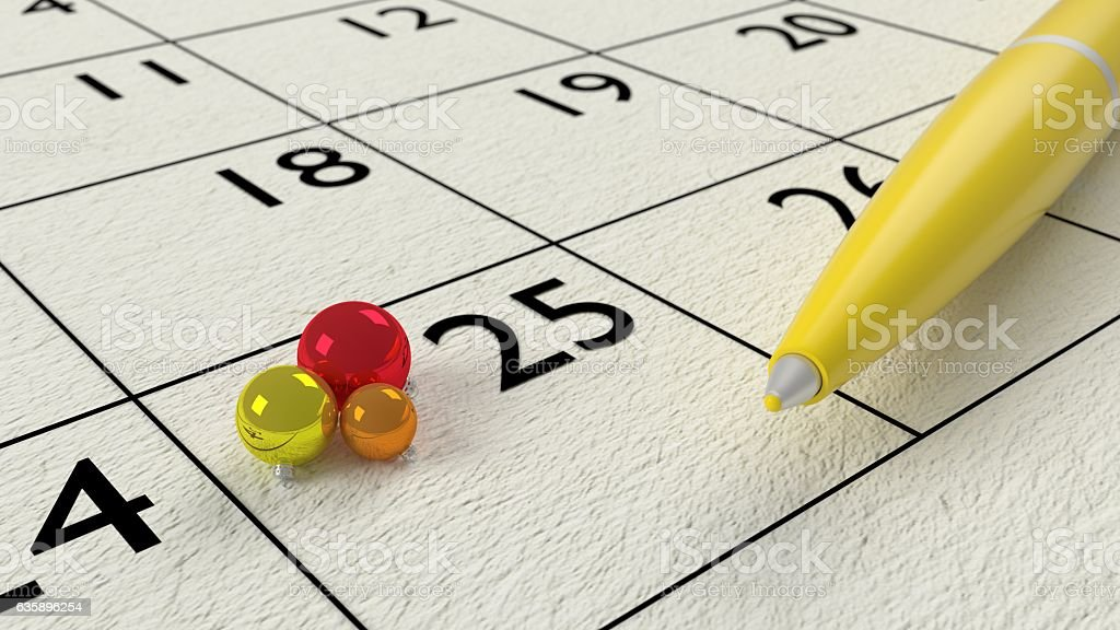 Yellow ballpen on a paper calendar closeup stock photo