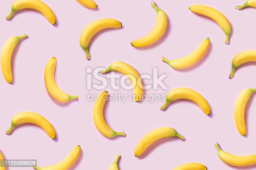 Yellow bananas pattern on pink background
