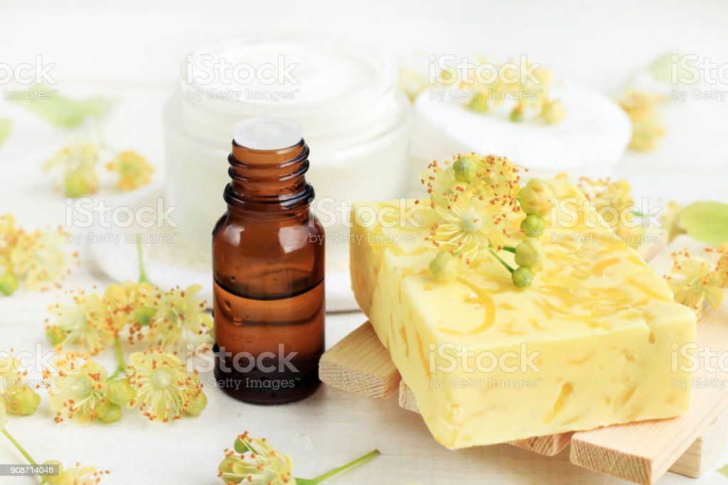 Yellow Bar of soap handmade with lime blossom, aromatic essential oils stock photo