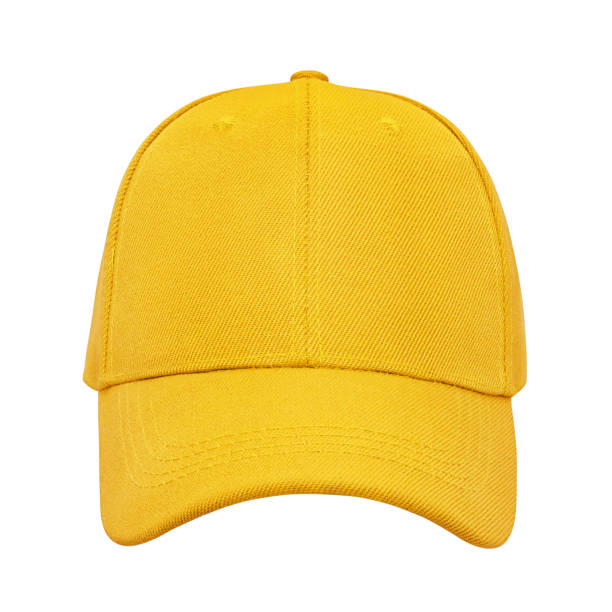 yellow baseball cap isolated - helmet visor stock photos and pictures