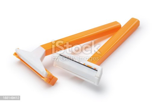 Two plastic, disposable razors isolated on white.