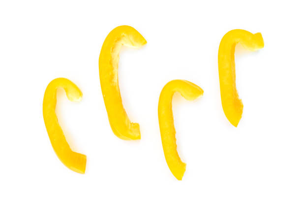 yellow bell pepper cut into pieces on white background, top view. yellow bell pepper cut into pieces on white background, top view. yellow bell pepper stock pictures, royalty-free photos & images
