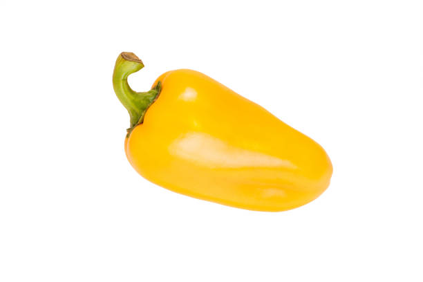 Yellow bell pepper on a white background One isolated yellow bell pepper yellow bell pepper stock pictures, royalty-free photos & images