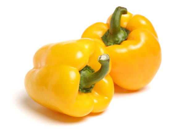 Yellow  bell  peppers on white background Yellow  bell  peppers on white background yellow bell pepper stock pictures, royalty-free photos & images