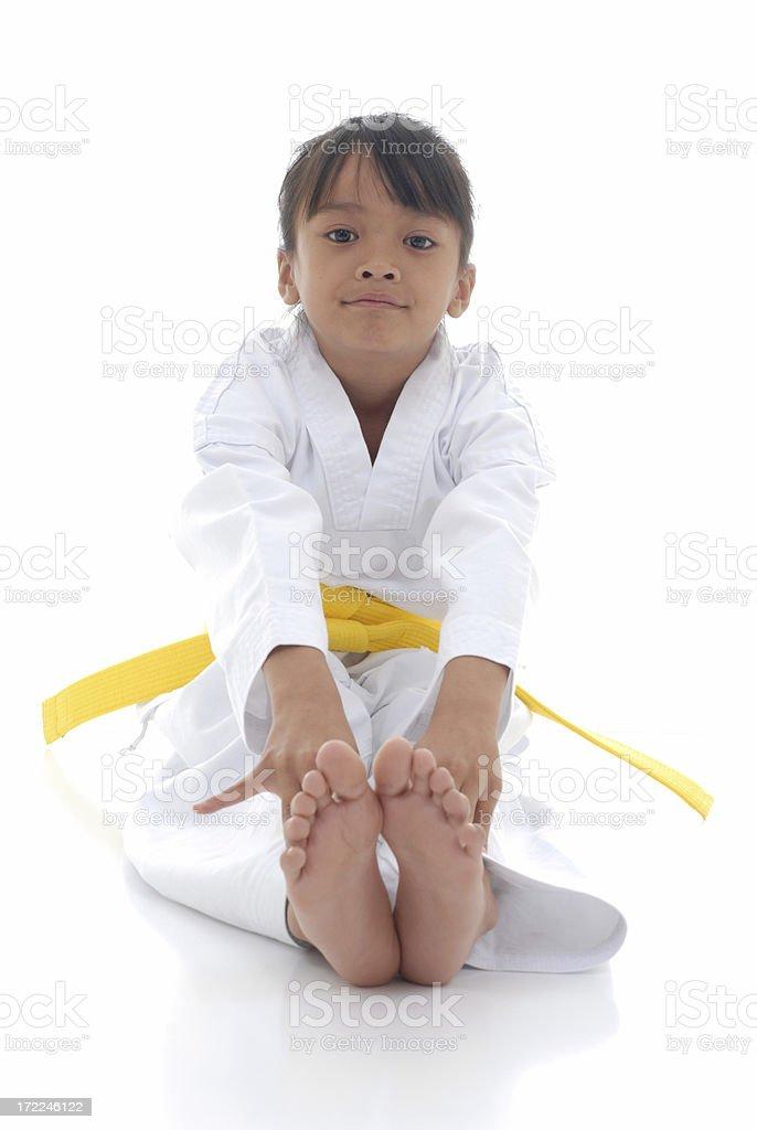 Yellow belt stretching stock photo