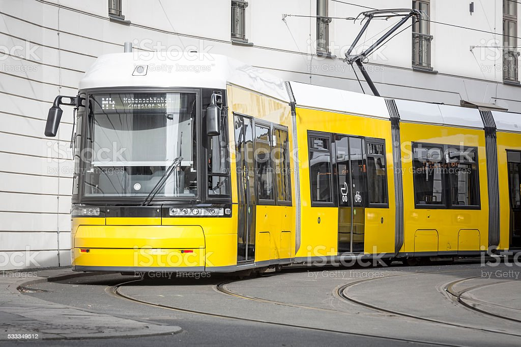 yellow berlin tram stock photo
