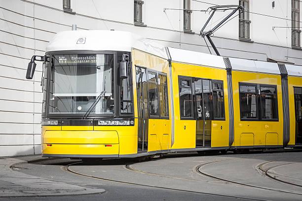 yellow berlin tram stock photo