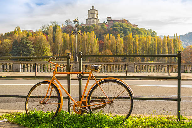 Yellow bicycle along the river in Turin (Piedmont, Italy) stock photo
