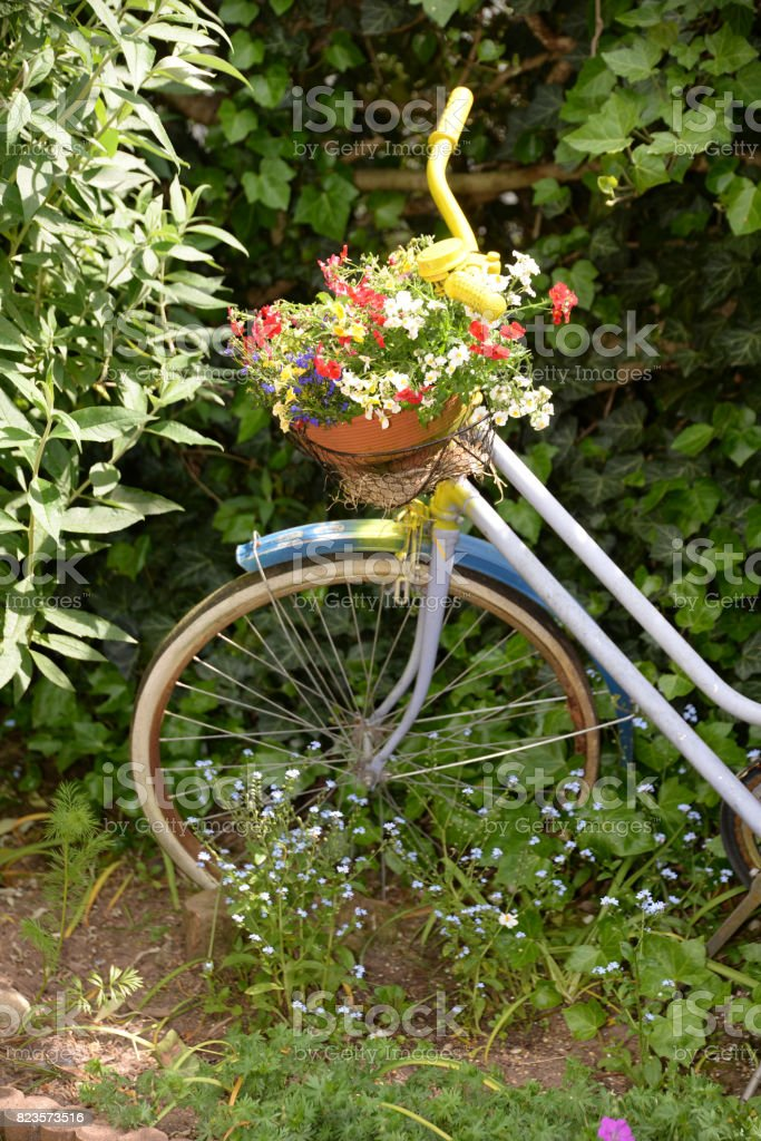 Yellow bicycle with flower decoration stock photo