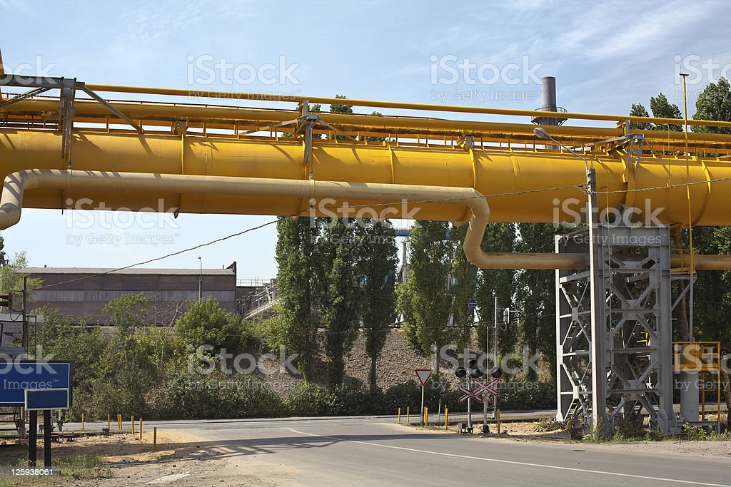 Yellow big gas pipelines at an industrial factory royalty-free stock photo