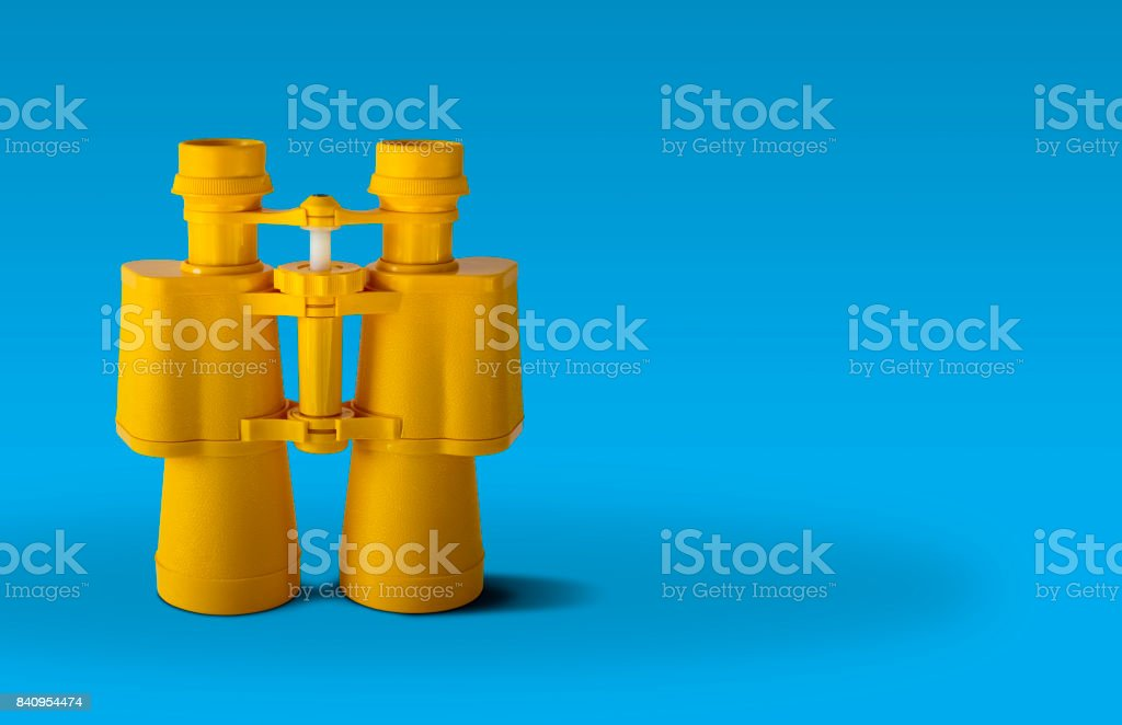 Yellow binoculars stock photo