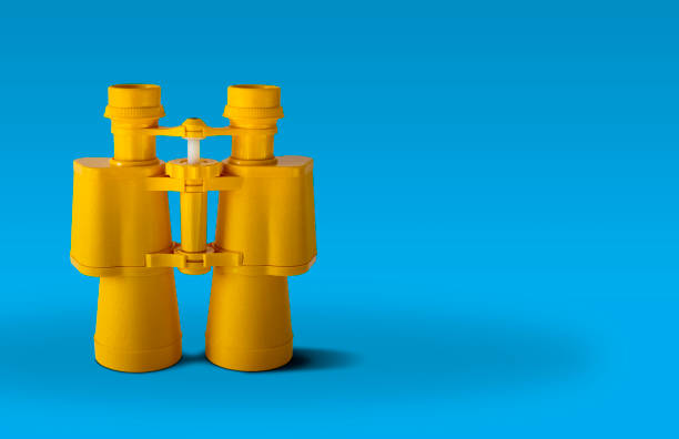 yellow binoculars - isolated colour stock photos and pictures