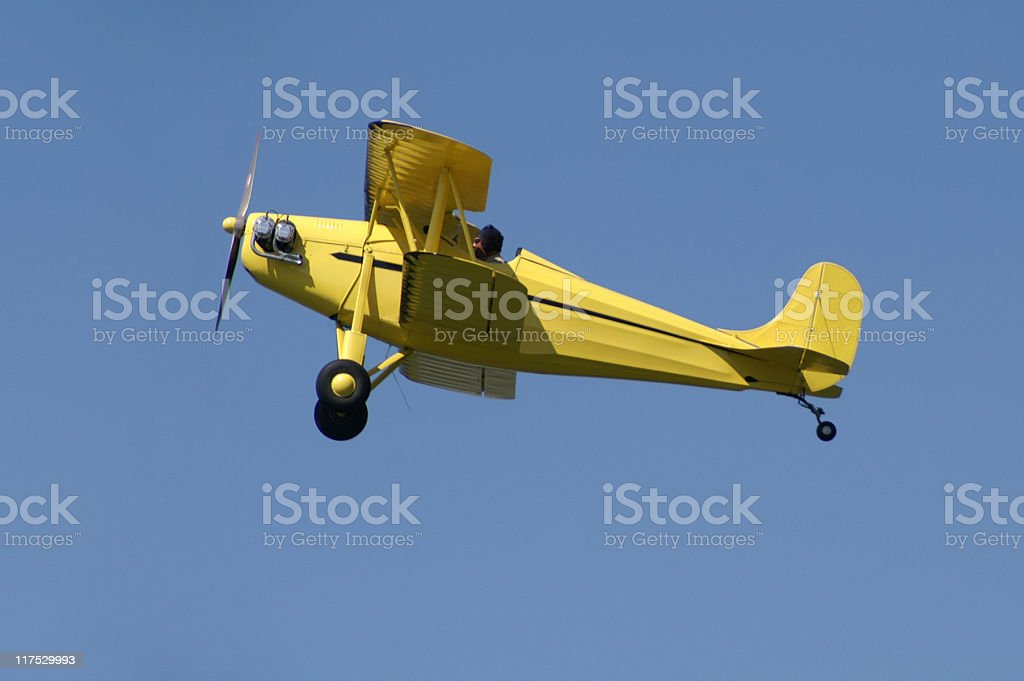 yellow biplane Rhinehart Rose Parrakeet A4C flying in blue sky stock photo