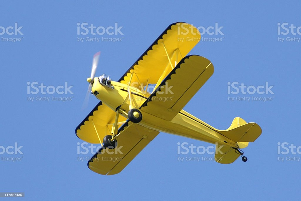 yellow biplane Rhinehart Rose Parrakeet A4C in clear blue sky stock photo